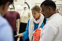 Melanie Dürr, a Fairtrade personnel, looks at clothing designs in the design room at the Pratibha vertically integrated garment unit in Indore, Madhya Pradesh, India on 11 November 2014. Photo by Suzanne Lee for Fairtrade