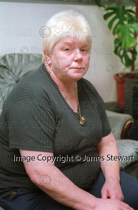 Notorious &lsquo; family from hell &rsquo; matriarch Big Mags Haney who has died of lung cancer&hellip; The picture goes back to where it all began pictured in her home in Raploch, Stirling in May 1995 after claiming that Sheriffs would be out of a job if it wasn't for her family.<br /> <br /> Picture taken 6th May 1995  <br /> jsp002_haney   <br /> Copyright  Pic : James Stewart    <br /> James Stewart Photography, 19 Carronlea Drive, Falkirk. FK2 8DN      <br /> Vat Reg No. 607 6932 25     <br /> Mobile : +44 (0)7721 416997    <br /> E-mail  :  jim@jspa.co.uk    <br /> If you require further information then contact Jim Stewart on any of the numbers above .....