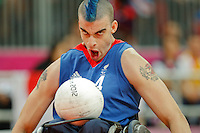 07.09.2012 Basketball Arena, London 2012 Wheelchair Rugby Paralympic Games at the Olympic Park. Picture shows action from Great Britain V. Japan Pool Match. No.4 David Anthony (GBR) attacks the Japanese goal line.