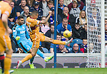 Marevin Johnson charges down the clearance from Rangers keeper Wes Foderingham