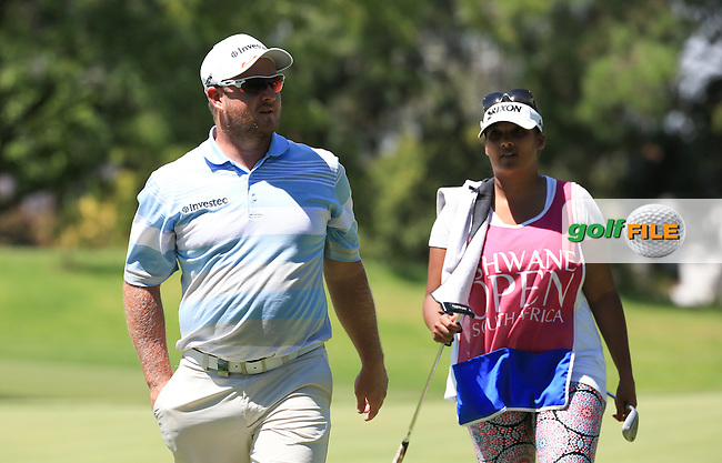 Merrick Bremner (RSA) followed by his wife Povesnie during Round Three of the 2016 Tshwane Open, played at the Pretoria Country Club, Waterkloof, Pretoria, South Africa.  13/02/2016. Picture: Golffile | David Lloyd<br /> <br /> All photos usage must carry mandatory copyright credit (&copy; Golffile | David Lloyd)