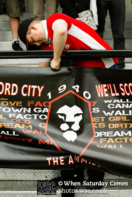 Salford City 2 FC United of Manchester 1, 15/07/2017. Moor Lane, Pre Season Friendly. Salford fans seciring a banner at Salford City v FC United of Manchester in a pre season friendly at Moor Lane Salford. Photo by Paul Thompson.