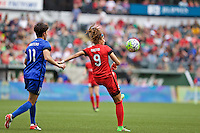 Portland, Oregon - Sunday May 29, 2016: Portland Thorns FC forward Nadia Nadim (9) and Seattle Reign FC midfielder Keelin Winters (11). The Portland Thorns play the Seattle Reign during a regular season NWSL match at Providence Park.