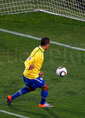 28 06 2010  Luis Fabiano Brazil beats the Chile keeper to the ball and scores Brazils second goal. Brazil v Chile, Johannesburg, South Africa.