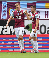 Burnley's Chris Wood is congratulated by Johann Guomundsson after scoring his team's opening goal<br /> <br /> Photographer Dave Howarth/CameraSport<br /> <br /> The Premier League - Burnley v Brighton & Hove Albion - Sunday 26th July 2020 - Turf Moor - Burnley<br /> <br /> World Copyright © 2020 CameraSport. All rights reserved. 43 Linden Ave. Countesthorpe. Leicester. England. LE8 5PG - Tel: +44 (0) 116 277 4147 - admin@camerasport.com - www.camerasport.com