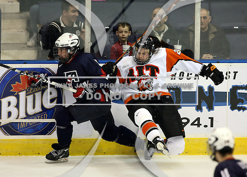 January 30, 2009:  Anton Kharin (22) of the Rochester Institute of Technology (RIT) checks Kyle Palmieri (10) during an exhibition game vs. Team USA at Blue Cross Arena in Rochester, NY.  Team USA defeated R.I.T. 6-3.  Photo copyright Mike Janes Photography 2009