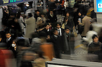 Commuters make their way home in the Shinjuku ward of  Tokyo, Japan. Japan has been hit extremely hard by the economic crisis and hundreds of thousands have lost their jobs in the last two months..09 Feb 2009