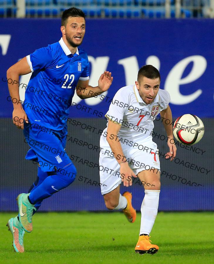 Fudbal<br /> Prijateljski mec-Friendly match<br /> Srbija v Grcka<br /> Zoran Tosic (R) and Andreas Samaris<br /> Chania, 17.11.2014.<br /> foto: Srdjan Stevanovic/Starsportphoto &copy;
