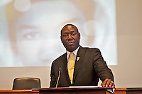 "Benjamin Crump attorney for the families of Trayvon Martin and Mike Brown speaking at ""Checking Under the Hood: Defining Trayvon Martin's Legacy, From Conversation to Legislation"" at Harvard Law School Cambridge MA with Sybrina Fulton Trayvon Martin's mother hosted by Professor Charles Ogletree of the Charles Hamilton Houston Institute at Austin Hall Ames Courtroom November 18, 2013"