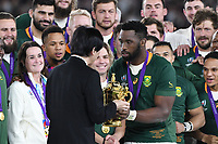 1st November 2019, Yokohama, Japan;  Siya Kolisi of South Africa receives the winners trophy from Japan's Crown Prince Akishino during the award ceremony after  the 2019 Rugby World Cup Final match between England and South Africa at the International Stadium Yokohama in Yokohama, Kanagawa, Japan on November 2, 2019.