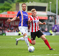 Lincoln City's Elliott Whitehouse vies for possession with Exeter City's Ryan Harley<br /> <br /> Photographer Chris Vaughan/CameraSport<br /> <br /> The EFL Sky Bet League Two Play Off First Leg - Lincoln City v Exeter City - Saturday 12th May 2018 - Sincil Bank - Lincoln<br /> <br /> World Copyright &copy; 2018 CameraSport. All rights reserved. 43 Linden Ave. Countesthorpe. Leicester. England. LE8 5PG - Tel: +44 (0) 116 277 4147 - admin@camerasport.com - www.camerasport.com