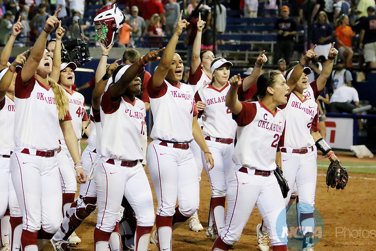 06 JUNE 2016: University of Oklahoma players celebrate their victory over Auburn University during the Division I Women's Softball Championship held at ASA Hall of Fame Stadium in Oklahoma City, OK.  University of Oklahoma defeated Auburn University in Game 1 by the final score of 3-2. Shane Bevel/NCAA Photos