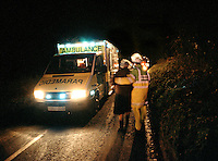 Paramedic ambulance crew attending a road traffic accident. This image may only be used to portray the subject in a positive manner..©shoutpictures.com..john@shoutpictures.com