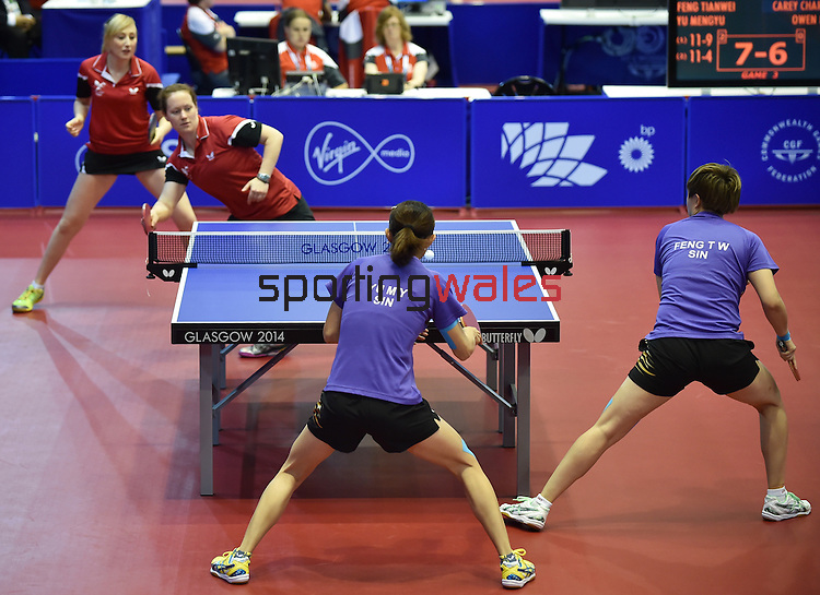 Wales Charlotte Carey and Naomi Owen in action in todays match against Singaport<br /> <br /> Photographer Ian Cook/Sportingwales<br /> <br /> 20th Commonwealth Games - Table Tennis -  Day 9 -  Friday 1st August 2014 - Glasgow - UK
