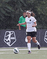Portland Thorns FC substitute forward Tiffany Weimer (19) brings the ball forward.  In a National Women's Soccer League (NWSL) match, Portland Thorns FC (white/black) defeated Boston Breakers (blue), 2-1, at Dilboy Stadium on July 21, 2013.