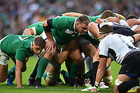 Nathan White of Ireland prepares to scrummage against his opposite number. Rugby World Cup Pool D match between Ireland and Romania on September 27, 2015 at Wembley Stadium in London, England. Photo by: Patrick Khachfe / Onside Images
