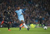 Tosin Adarabioyo of Manchester City under pressure from Moussa Dembele of Celtic during the UEFA Champions League GROUP match between Manchester City and Celtic at the Etihad Stadium, Manchester, England on 6 December 2016. Photo by Andy Rowland.
