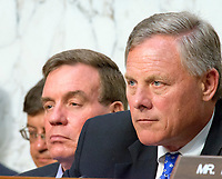 "United States Senator Richard Burr (Republican of North Carolina), Chairman, US Senate Select Committee on Intelligence, right, and US Senator Mark Warner (Democrat of Virginia), Ranking Member, US Senate Select Committee on Intelligence, left, listen as US Attorney General Jeff Sessions gives testimony before the committee to ""examine certain intelligence matters relating to the 2016 United States election"" on Capitol Hill in Washington, DC on Tuesday, June 13, 2017.  In his prepared statement Attorney General Sessions said it was an ""appalling and detestable lie"" to accuse him of colluding with the Russians. Photo Credit: Ron Sachs/CNP/AdMedia"