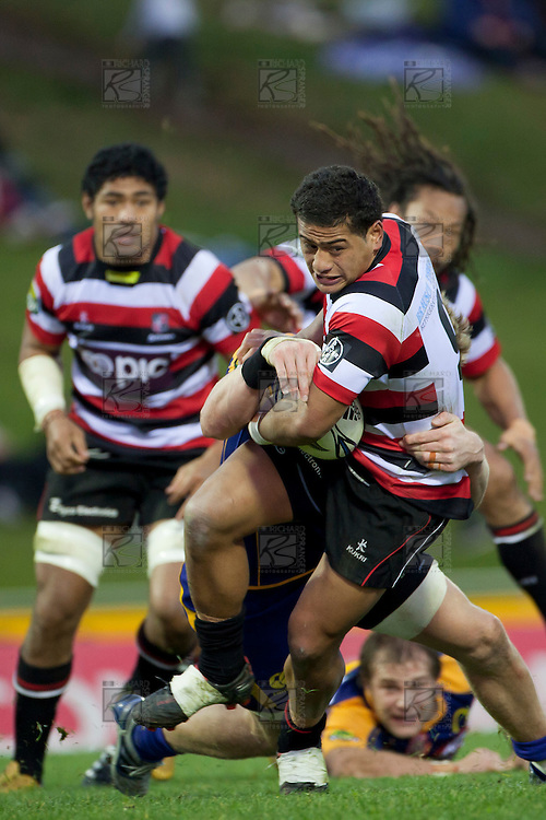 August Pulu fights his way forward as he is tackled by Adam Thomson. ITM Cup Round 1 game between the Counties Manukau Steelers and Otago, played at Bayer Growers Stadium, Pukekohe, on Saturday July 31st 2010. Counties Manukau Steelers won 29 - 13 after leading 22 - 6 at halftime.