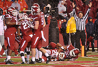 NWA Media/Michael Woods --11/22/2014-- w @NWAMICHAELW...University of Arkansas players celebrate after Rohan Gaines (26) returns an interception for a touchdown in the 3rd quarter of Arkansas 30-0 win over Ole Miss during Saturdays game at Razorback Stadium.