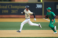 Bruce Steel (17) of the Wake Forest Demon Deacons hustles towards second base as Notre Dame Fighting Irish first baseman Daniel Jung (31) trails behind at David F. Couch Ballpark on March 10, 2019 in  Winston-Salem, North Carolina. The Demon Deacons defeated the Fighting Irish 7-4 in game one of a double-header.  (Brian Westerholt/Four Seam Images)