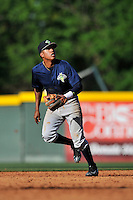 Shortstop Milton Ramos (7) of the Columbia Fireflies follows a pop fly in a game against the Greenville Drive on Sunday, April 24, 2016, at Fluor Field at the West End in Greenville, South Carolina. Greenville won, 5-1. (Tom Priddy/Four Seam Images)