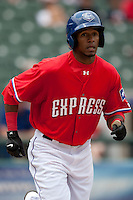 Round Rock Express outfielder Julio Borbon #20 runs to first during the Pacific Coast League baseball game against the Iowa Cubs on April 15, 2012 at the Dell Diamond in Round Rock, Texas. The Express beat the Cubs 11-10 in 13 innings. (Andrew Woolley / Four Seam Images).