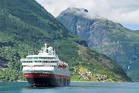 Hurtigruten coastal ferry at port in Geiranger fjord, Norway