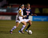 Julia Roberts (8) of Virginia keeps close to Alex Reed (7) of Maryland during the game in College Park, MD.  Maryland defeated Virginia, 3-1.