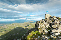Siobhan Miller practising yoga at the Tryfan summit.