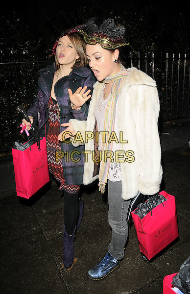 GUEST & JAIME WINSTONE.The Ann Summers Enchantment Collection launch party, The Baccarat Room, 1 Marylebone Rd., London, England..December 1st, 2008.anne full length Jamie blue doctor Martins Dms DM boots Doc white cream fur coat jeans denim scarf grey gray striped stripes hat zig zag red dress purple mouth open funny face .CAP/CAN.©Can Nguyen/Capital Pictures.