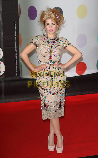 Paloma Faith.Arrivals for The 2013 Brit Awards at the O2 Arena, London, England..February 20th 2013.BRITS full length embellished gold beaded dress jewelled high neck hands on hips blue green stones platform white shoes clutch bag brooches in hair clips .CAP/ROS.©Steve Ross/Capital Pictures