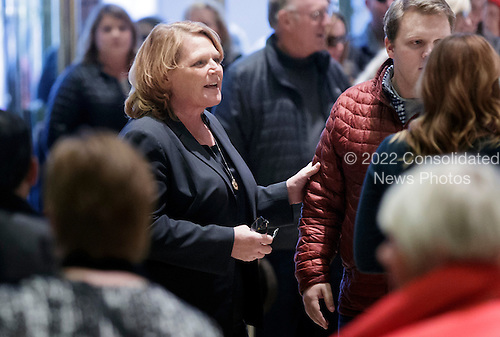 United States Senator Heidi Heitkamp (Democrat of from North Dakota), center, walks through the lobby of Trump Tower for a meeting with President-elect Donald Trump in New York, New York, USA, 02 December 2016.<br /> Credit: Justin Lane / Pool via CNP