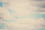 a world war 2 spitfire flies through the clouds