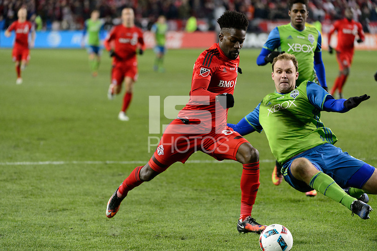 Toronto, ON, Canada - Saturday Dec. 10, 2016: Benoit Cheyrou, Chad Marshall during the MLS Cup finals at BMO Field. The Seattle Sounders FC defeated Toronto FC on penalty kicks after playing a scoreless game.