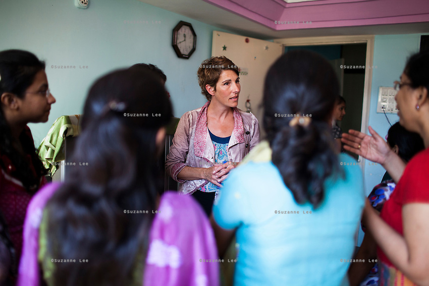 Tamsin Greig, an actress from the United Kingdom, speaks with Tearfund beneficiaries in Nirmal Bhavan, a rehabilitation home for trafficked and rescued girls run by Tearfund partner NGO Oasis India, in Mumbai, Maharashtra, India on 20 February 2014. Photo by Suzanne Lee/Tearfund