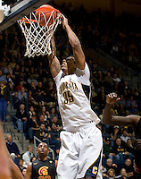 Richard Solomon of California dunks the ball during the game against USC at Haas Pavilion in Berkeley, California on February 17th, 2013.  California defeated USC, 76-68.