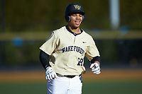 Christian Long (19) of the Wake Forest Demon Deacons rounds the bases after hitting a home run against the Gardner-Webb Runnin' Bulldogs at David F. Couch Ballpark on February 18, 2018 in  Winston-Salem, North Carolina. The Demon Deacons defeated the Runnin' Bulldogs 8-4 in game one of a double-header.  (Brian Westerholt/Four Seam Images)