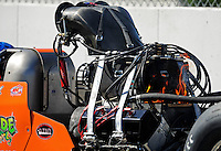Feb. 10, 2012; Pomona, CA, USA; Fire comes from the engine on the car of NHRA top alcohol dragster driver Mike Austin during qualifying at the Winternationals at Auto Club Raceway at Pomona. Mandatory Credit: Mark J. Rebilas-