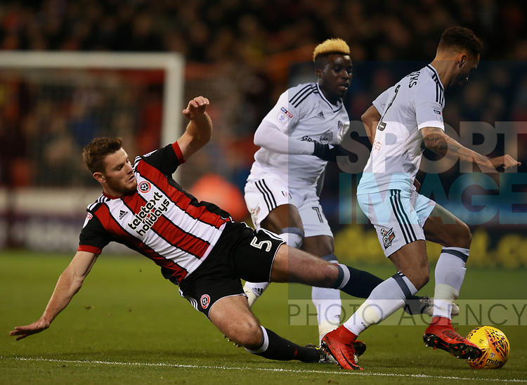 Jack O'Connell of Sheffield Utd tackles Ryan Fredericks of Fulham during the Championship match at Bramall Lane Stadium, Sheffield. Picture date 21st November 2017. Picture credit should read: Simon Bellis/Sportimage