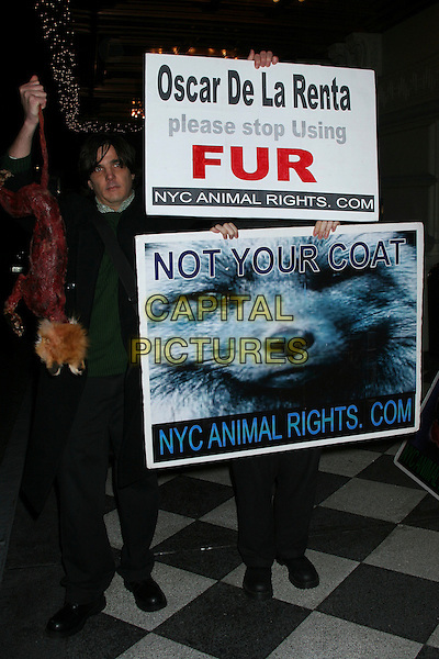 FUR PROTEST AGAINST OSCAR DE LE RENTA.The annual Gold Medal Gala held by Queen Sofia Spanish Institute to honor Julio Iglesias, Henrey Kissinger, Beatrice Santo Domingo at the Pierre Hotel in New York..USA, United States.28th November 2005.Ref:Ian Wilson.protest march poster banner sign fur Vanity Sucks NYC Animal Rights.www.capitalpictures.com.sales@capitalpictures.com.©Capital Pictures.