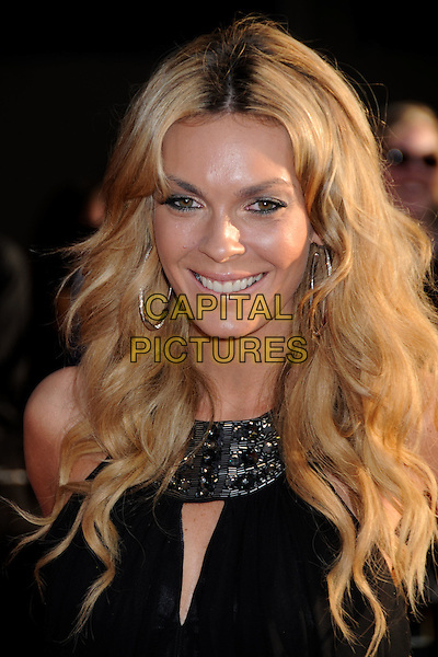 "JASMINE DUNSTIN .""Iron Man 2"" World Premiere held at the El Capitan Theatre, Hollywood, California, USA, 26th April 2010..arrivals portrait headshot black silver beaded neckline collar hoop earrings smiling .CAP/ADM/BP.©Byron Purvis/AdMedia/Capital Pictures."
