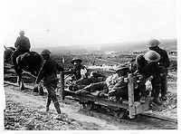 Canadian official photographs<br /> <br /> <br /> Some Canadian wounded being taken to the dressing station on a light railway from the firing line
