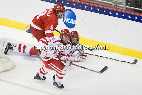 Tommy Wingels (Miami - 9), David Warsofsky (BU - 5), Eric Gryba (BU - 2) - The Boston University Terriers defeated the Miami University RedHawks 4-3 in overtime to win the 2009 NCAA D1 National Championship at the Frozen Four on Saturday, April 11, 2009, at the Verizon Center in Washington, DC.