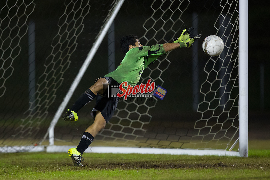 Kevin Gutierrez (31) of the Northwest Cabarrus Trojans makes a diving save during second half action against the Cox Mill Chargers at Cox Mill High School on November 4, 2015 in Concord, North Carolina.  The Chargers defeated the Trojans 6-1.  (Brian Westerholt/Sports On Film)