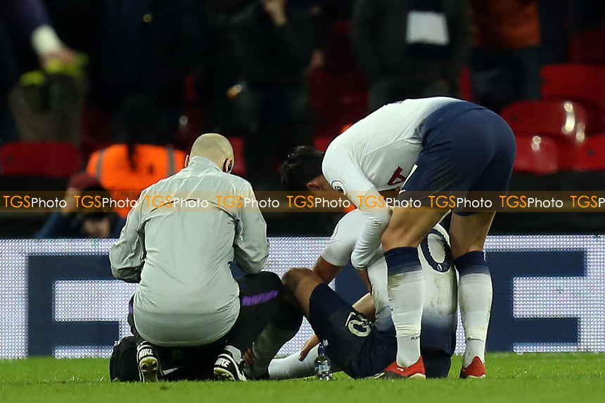 Harry Kane of Tottenham Hotspur is treated or an injury after the final whistle of Tottenham Hotspur vs Manchester United, Premier League Football at Wembley Stadium on 13th January 2019