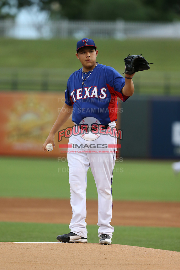 Luis Ortiz #29 of the AZL Rangers pitches against the AZL Cubs at Surprise Stadium on July 6, 2014 in Surprise, Arizona. (Larry Goren/Four Seam Images)