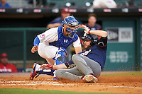 Lehigh Valley IronPigs designated hitter Darin Ruf (28) is tagged out at home by catcher Tony Sanchez (26) during a game against the Buffalo Bisons on July 9, 2016 at Coca-Cola Field in Buffalo, New York.  Lehigh Valley defeated Buffalo 9-1 in a rain shortened game.  (Mike Janes/Four Seam Images)