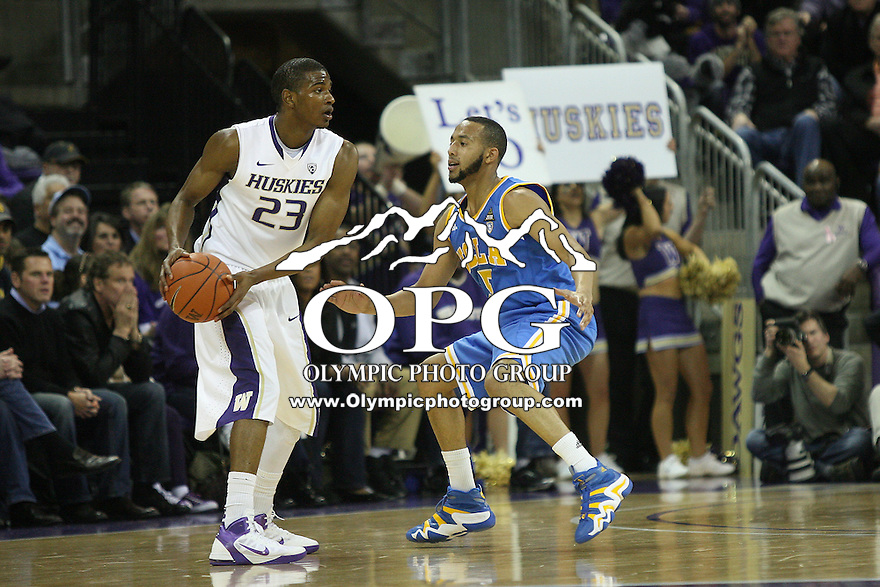 Mar 03, 2011:  Washington's #23 C.J. Wilcox looks for an open teammate to pass the ball to while being guarded by UCLA's #5 Jerime Anderson.  Washington defeated UCLA 70- 63 at Alaska Airlines Arena Seattle, Washington...