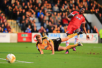 Last ditch tackle on Omar Bogle by MarkRoberts to leave score at one nil during the Sky Bet League 2 match between Cambridge United and Grimsby Town at the R Costings Abbey Stadium, Cambridge, England on 15 October 2016. Photo by PRiME Media Images.